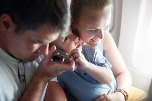 Try a podcast to sooth you and your family while in flight.